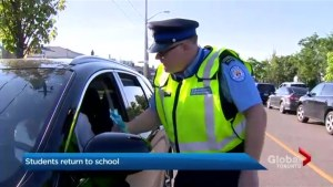 Police, parking enforcement educate parents on school zone driving safety